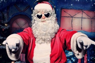 11044280-santa-claus-is-listening-to-music-in-headphones-christmas
