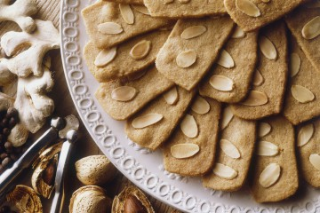speculaas-or-spekulatius-christmas-cookies-made-with-ginger-cinnamon-and-almonds-popular-in-belgium-and-germany-served-on-a-plate-alongside-nuts-and-nutcracker-view-from-above-88563135-5825ef485f9b58d5