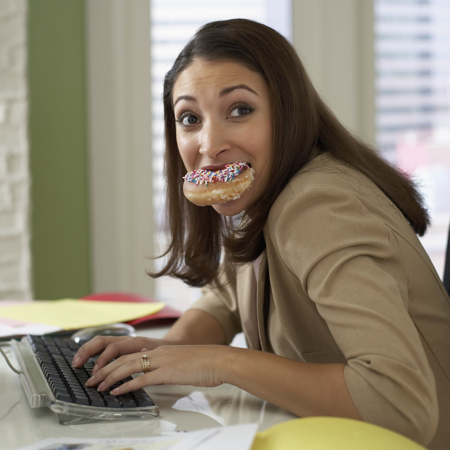 woman-eating-chocolate-donut-desk_0